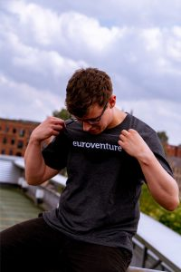 man wearing euroventure t shirt