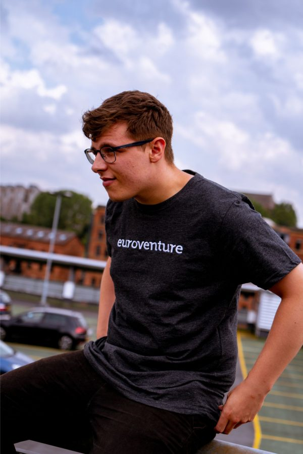 Man wearing grey euroventure tee
