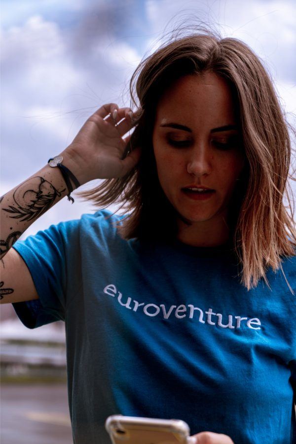 woman wearing blue euroventure tee