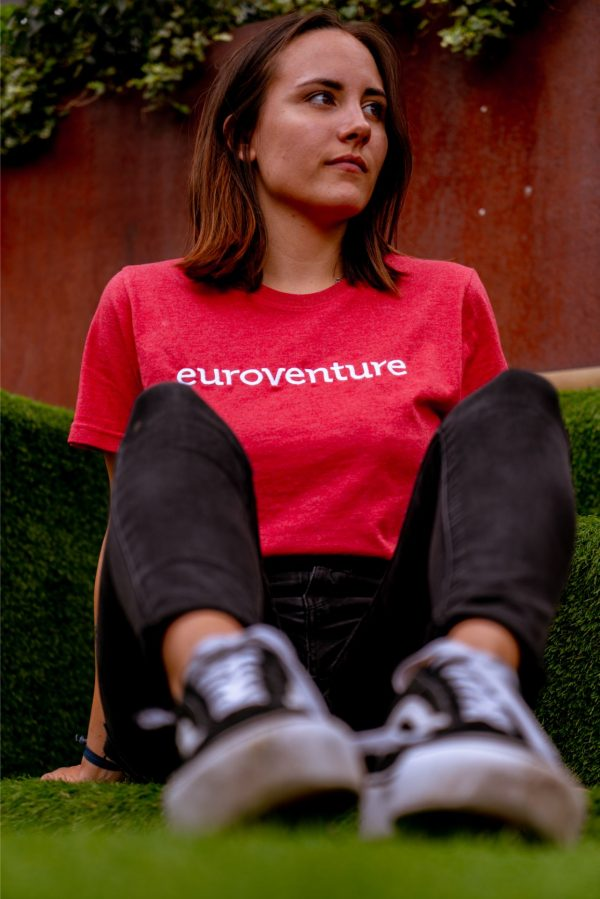 Woman wearing a red euroventure t shirt